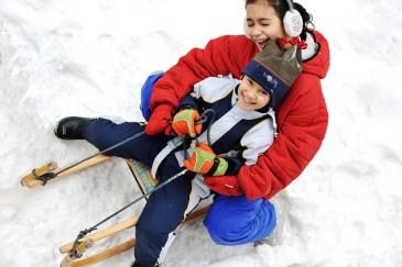 children_sledding_snowy_day_H